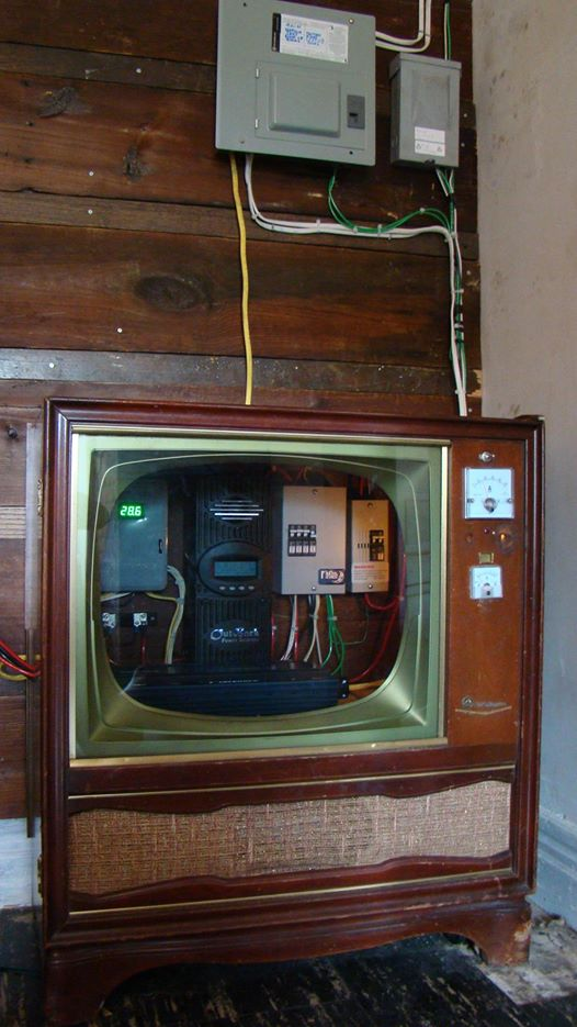 Off grid solar system built into an old television